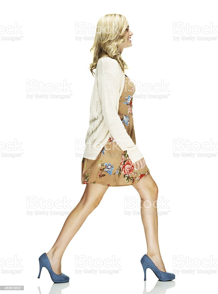 Side view of happy woman walking royalty-free stock photo