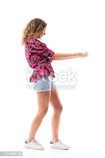 Side view of happy young woman with outstretched arms for hug inviting and greeting. Full body isolated on white background.