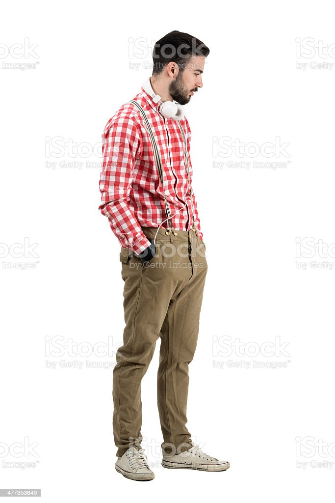 Side view of hipster dj with headphones around his neck stock photo