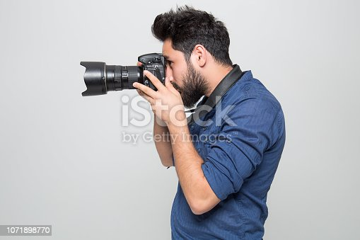 Photographer Photographing On white Background