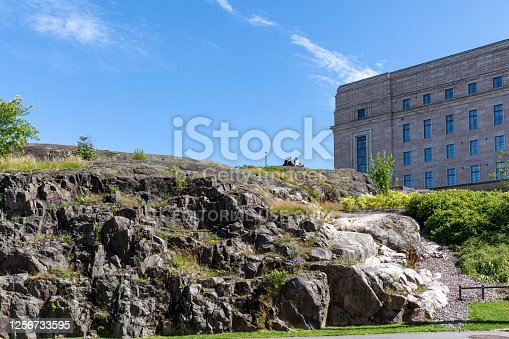 Helsinki, Finland - jun 12th 2020: Finnish parliament building is built on top of bedrock. The foundation is visible on the side of the building.