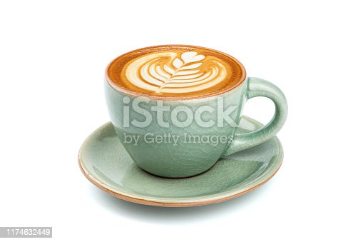 istock Side view of hot latte coffee with latte art in a ceramic green cup and saucer isolated on white background with clipping path inside. 1174632449