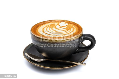 Side view of hot latte coffee with latte art in a vintage matt black cup and saucer isolated on white background with clipping path inside.