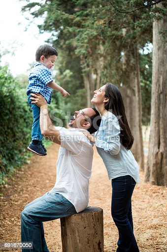 811227514 istock photo Side view of joyful latin family with one boy 691670050