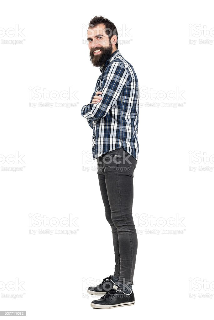Side view of laughing hipster with smiley piercing stock photo