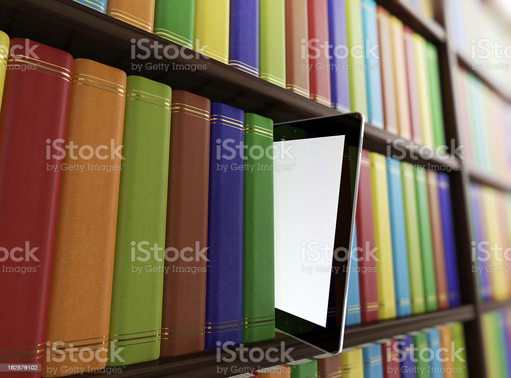 Side view of library with books and a tablet sticking out stock photo