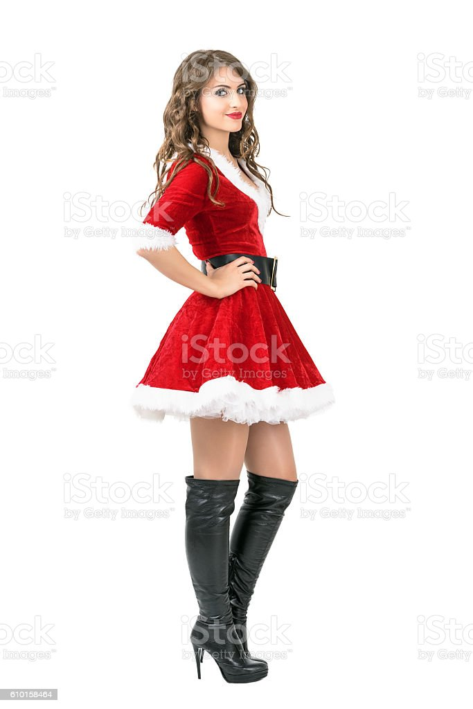 side view of lovely santa girl in christmas dress posing royalty free stock photo