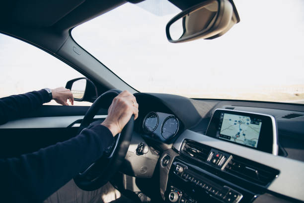 Side view of man driving car with navigation GPS stock photo