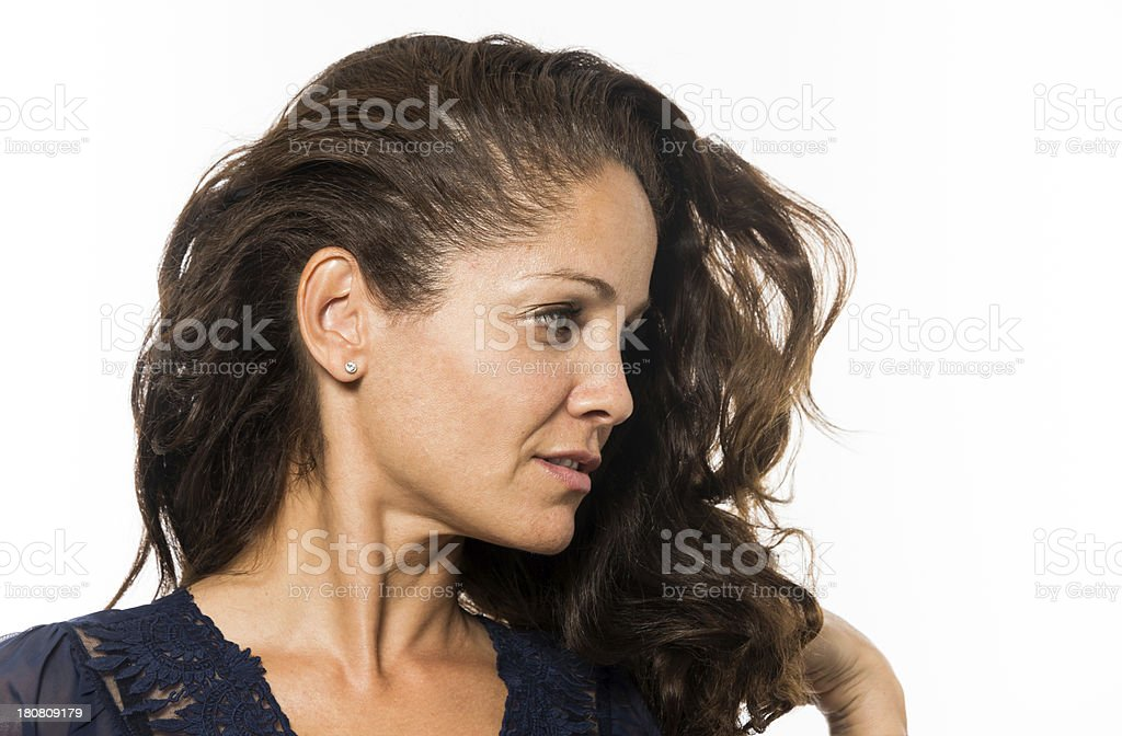 Side view of mature woman looking sideways against white. stock photo