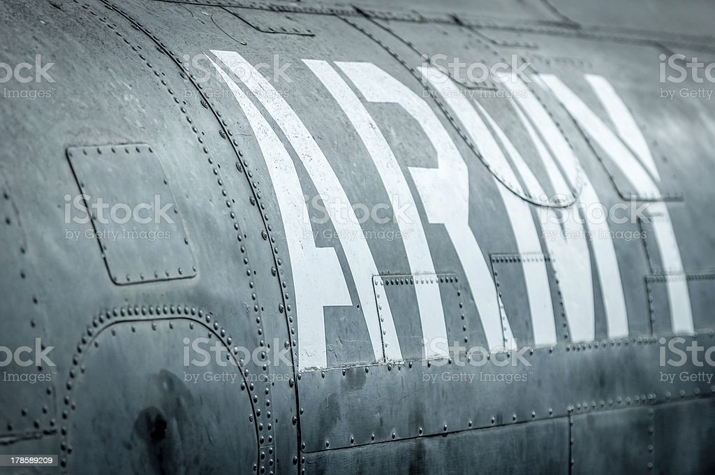 Side view of military plane with inscription. royalty-free stock photo