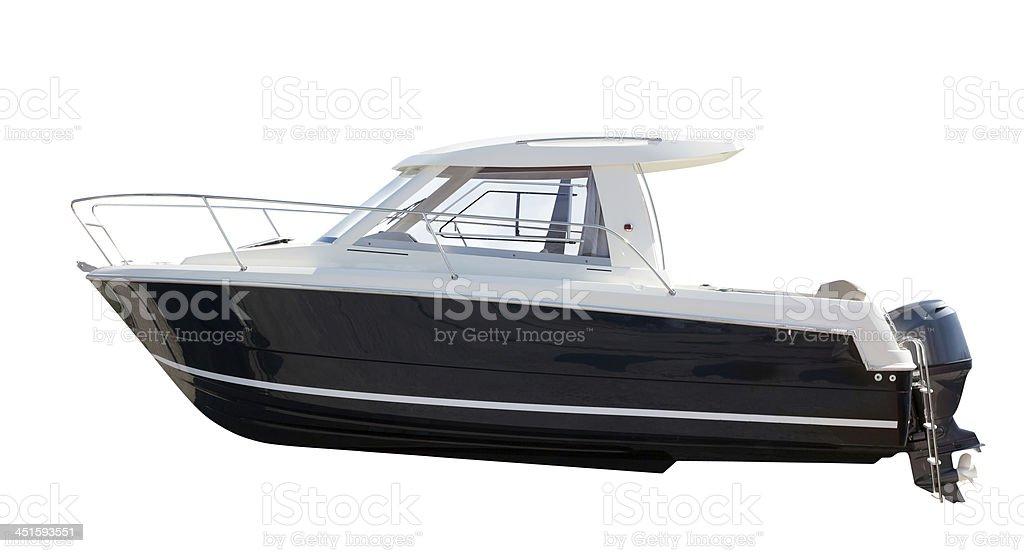 Vista lateral de um barco motorizado.  Isolado sobre o branco foto royalty-free