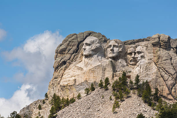Side view of Mount Rushmore with sunlight Side view of public monument Mount Rushmore with sunlight mount rushmore stock pictures, royalty-free photos & images