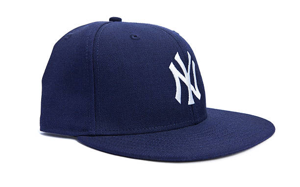 Side View of New York Yankees Ball Cap Taipei, Taiwan - December 17, 2012: This is a studio shot of a blue New York Yankees hat made by New Era isolated on a white background. major league baseball stock pictures, royalty-free photos & images