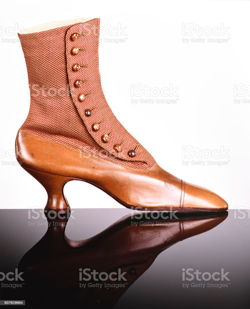 Side view of old elegant brown leather boots stock photo