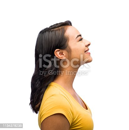 Side view of one young woman smiling in isolated on white background shot