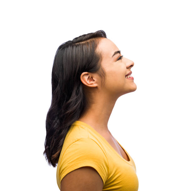 Side view of one young woman Side view of one young woman smiling in isolated on white background shot profile view stock pictures, royalty-free photos & images
