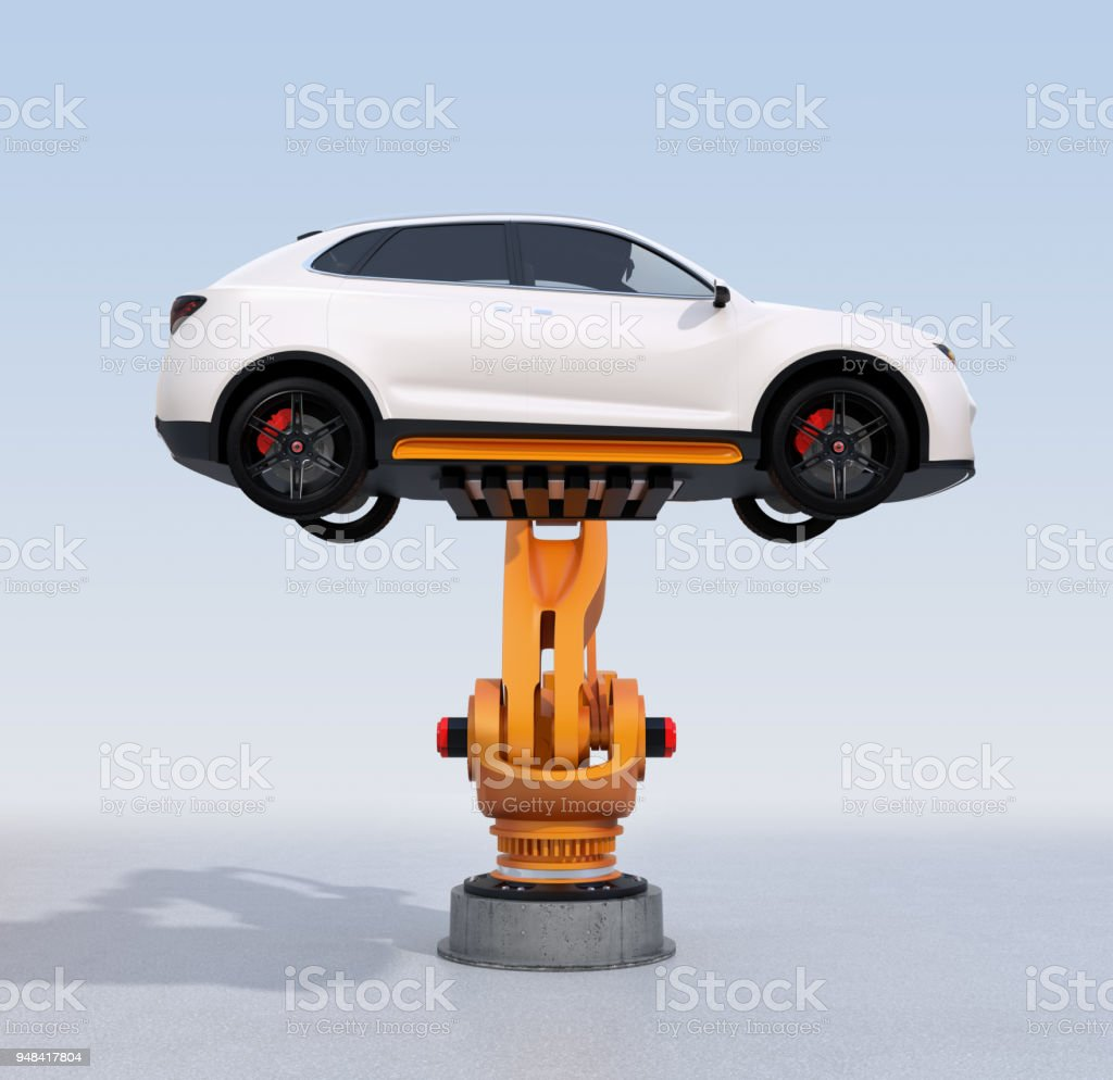 Side view of orange heavyweight robotic arm delivering white SUV on light blue background stock photo