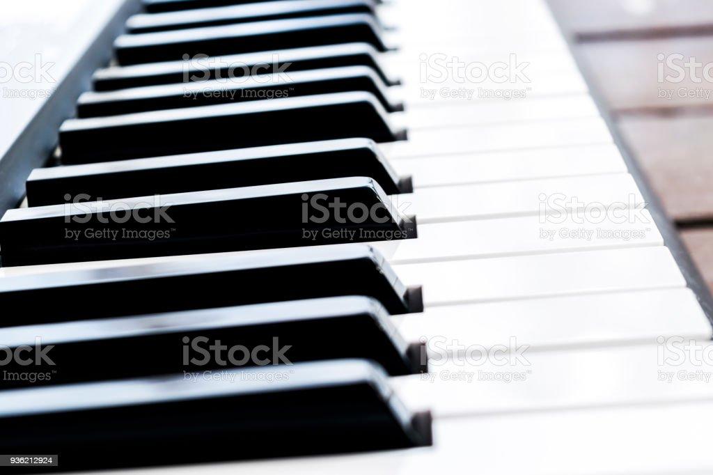 Side view of piano keys. Close-up of piano keys. Close frontal view....