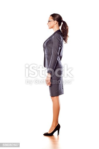 istock Side view of pretty business woman standing on white background 536082507