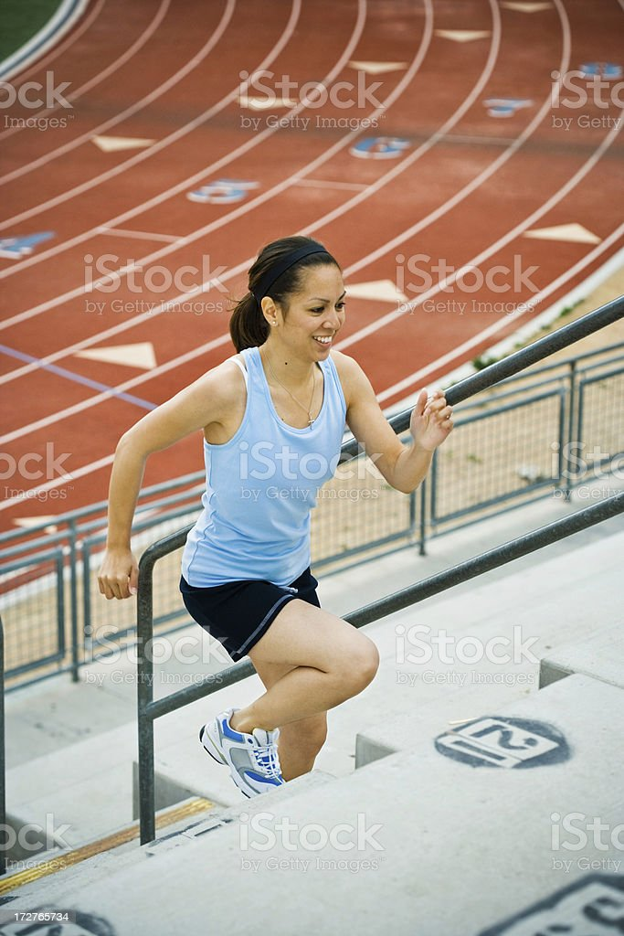 side view of runner up the stairs royalty-free stock photo