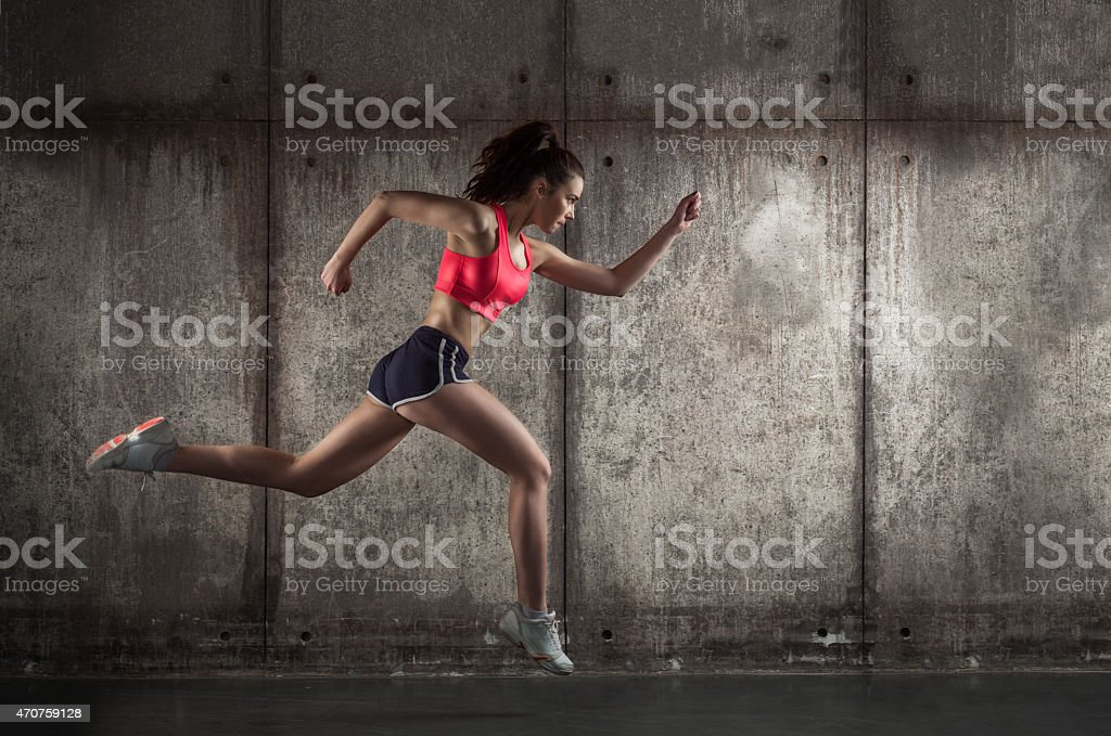 Side view of running woman stock photo