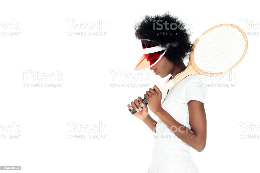 side view of sad female tennis player with racket isolated on white stock photo