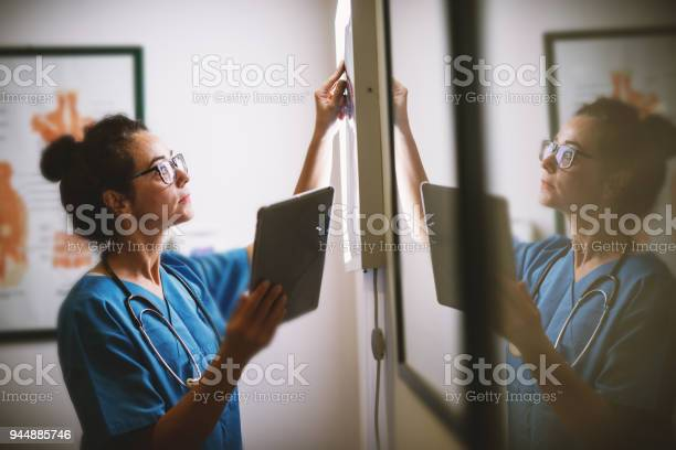 Side view of smiling middle aged nurse checking xray in a docto picture id944885746?b=1&k=6&m=944885746&s=612x612&h=diswtasicl0rlwyshsjba1b6ivqm2ofd6rd6ngfnsou=