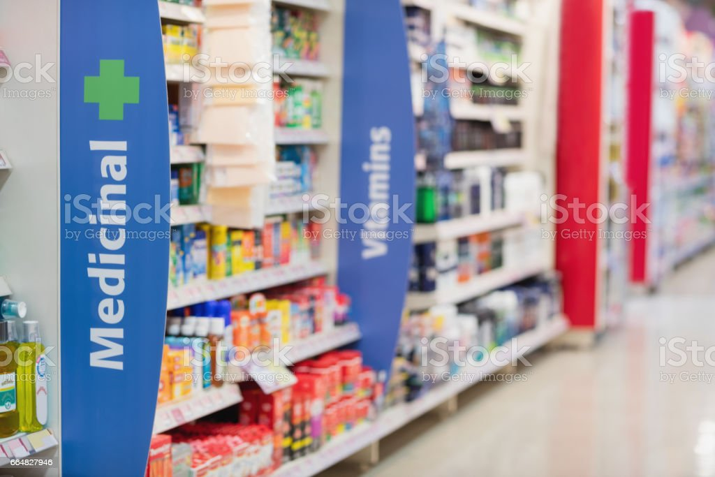 Side view of supermarket shelves stock photo