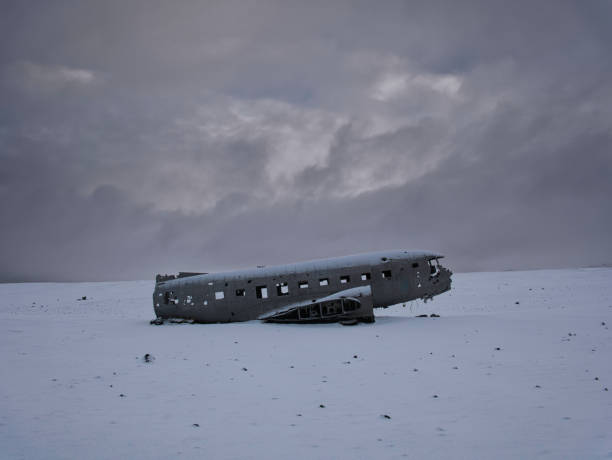 Side view of the DC-3 aircraft wreck in Iceland Side view of the DC-3 aircraft wreck in Iceland with fresh snow sólheimasandur stock pictures, royalty-free photos & images
