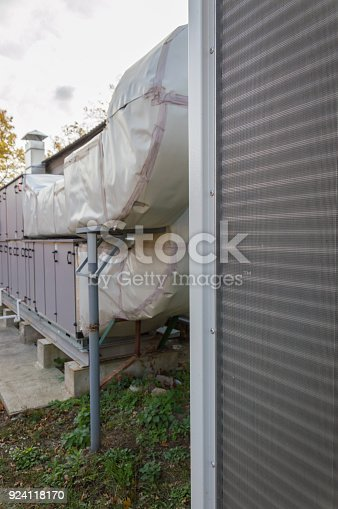 istock Side view of the gray commercial cooling unit for central ventilation system 924118170