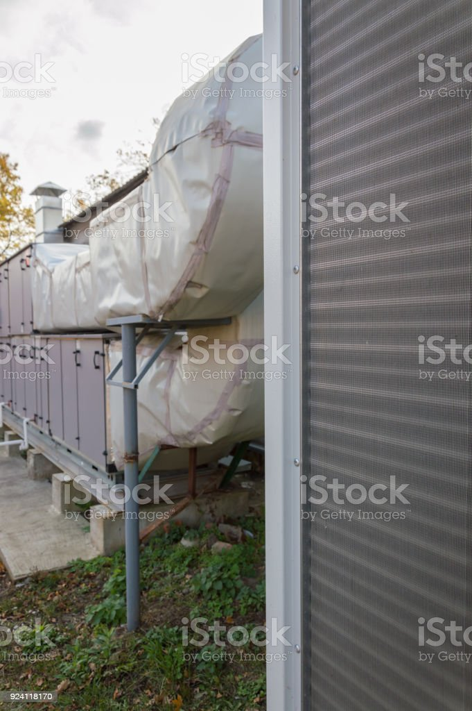 Side view of the gray commercial cooling unit for central ventilation system stock photo