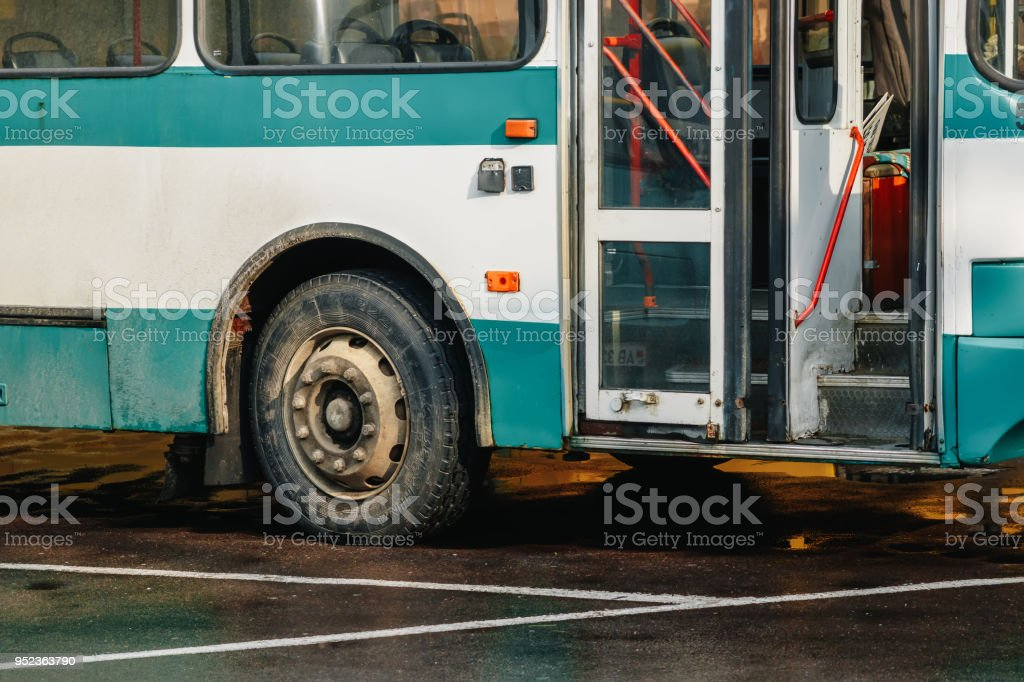 Side view of the green travel bus with door and bus wheel and copy...