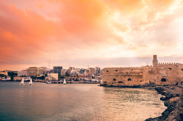 Side view of the old Venetian fortress known as Koules situated at the entrance of the old harbor. Crete, Greece stock photo