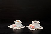 Side view of two cups of coffee on the lace napkins, Turkish dessert.  Space for text