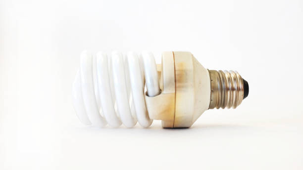 side view of used lightbulb on white wall background side view of used lightbulb on white wall background canadian football league stock pictures, royalty-free photos & images