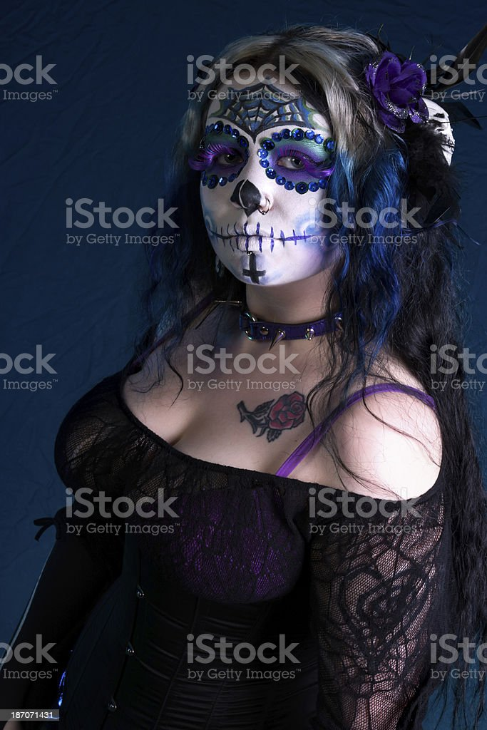 Side view of woman in blue sugarskull makeup. stock photo