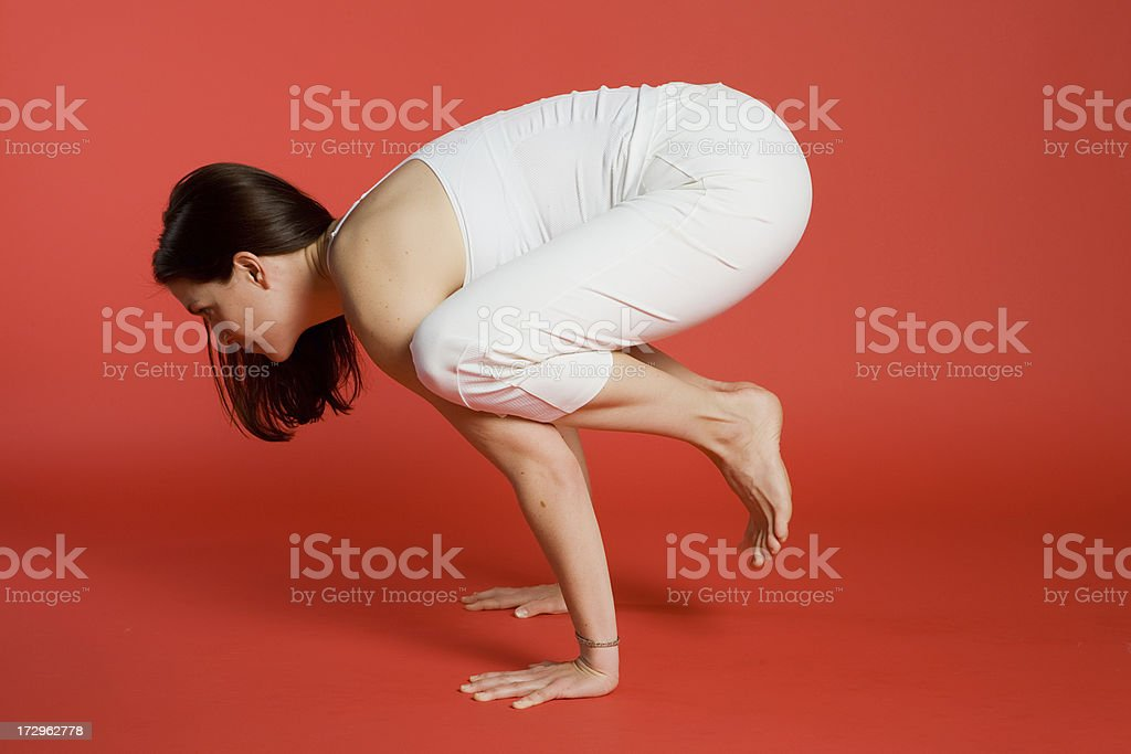 Side view of woman in crane pose royalty-free stock photo