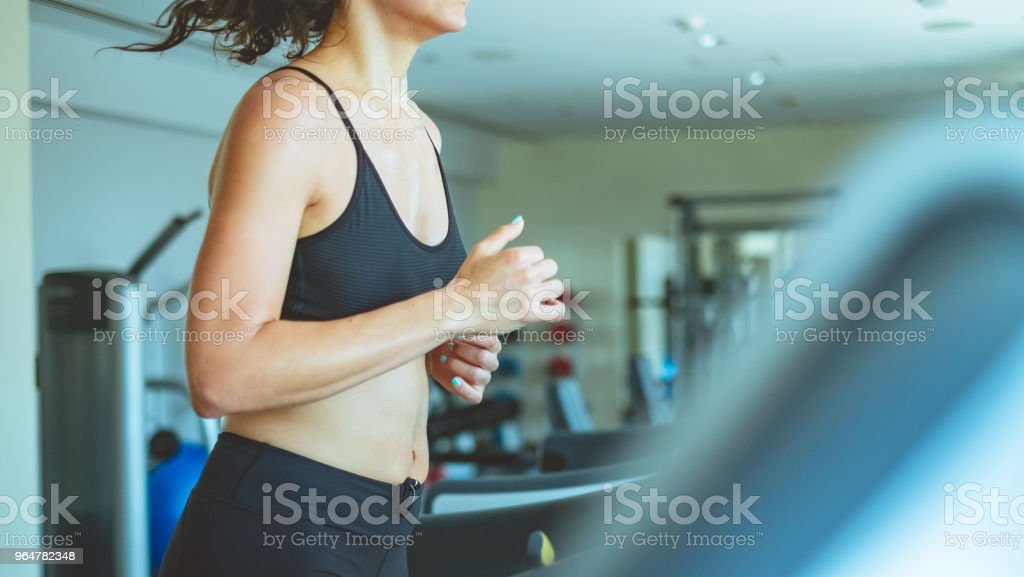 Side view of woman on treadmill royalty-free stock photo