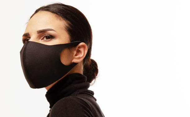side view of woman wearing a mask front of white background - indumento sportivo protettivo foto e immagini stock