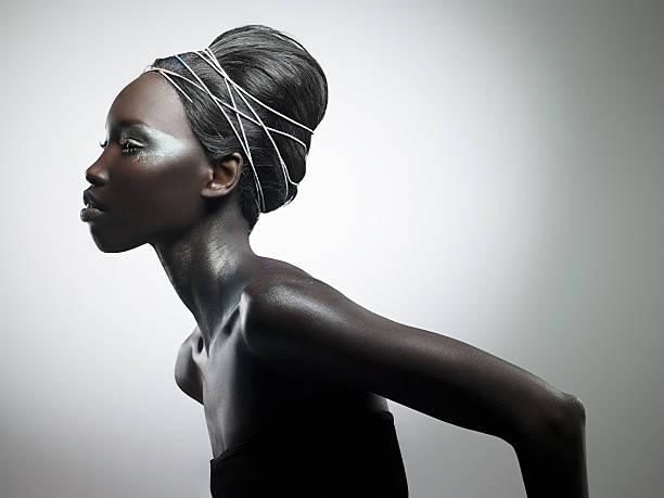 side view of woman with metallic make up - женская мода стоковые фото и изображения