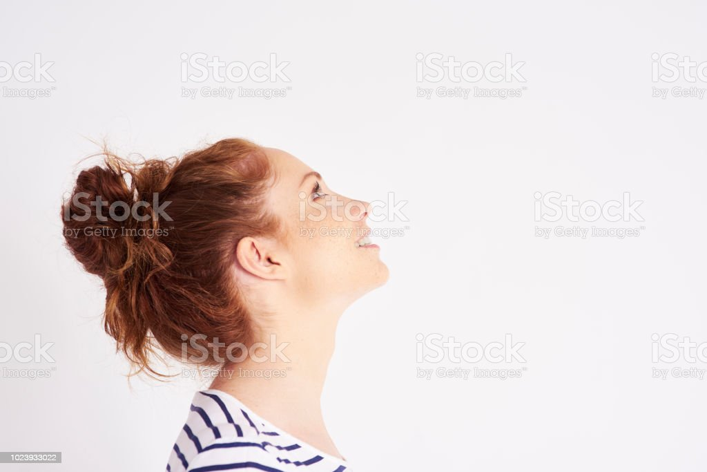 Side view of woman's face at studio shot stock photo