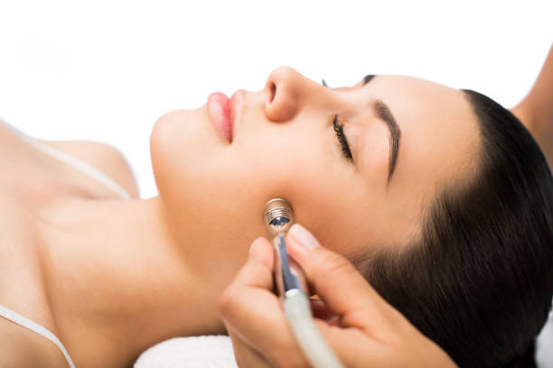 美容治療で女性の顔の側面図 ストックフォト