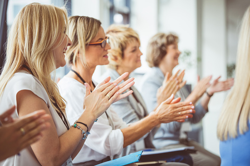 Side View Of Women Clapping Hands During Seminar Stock Photo - Download Image Now