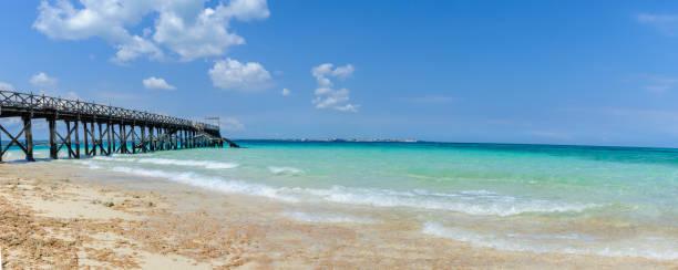Side view of wood pier at Prison Island in Zanzibar stock photo