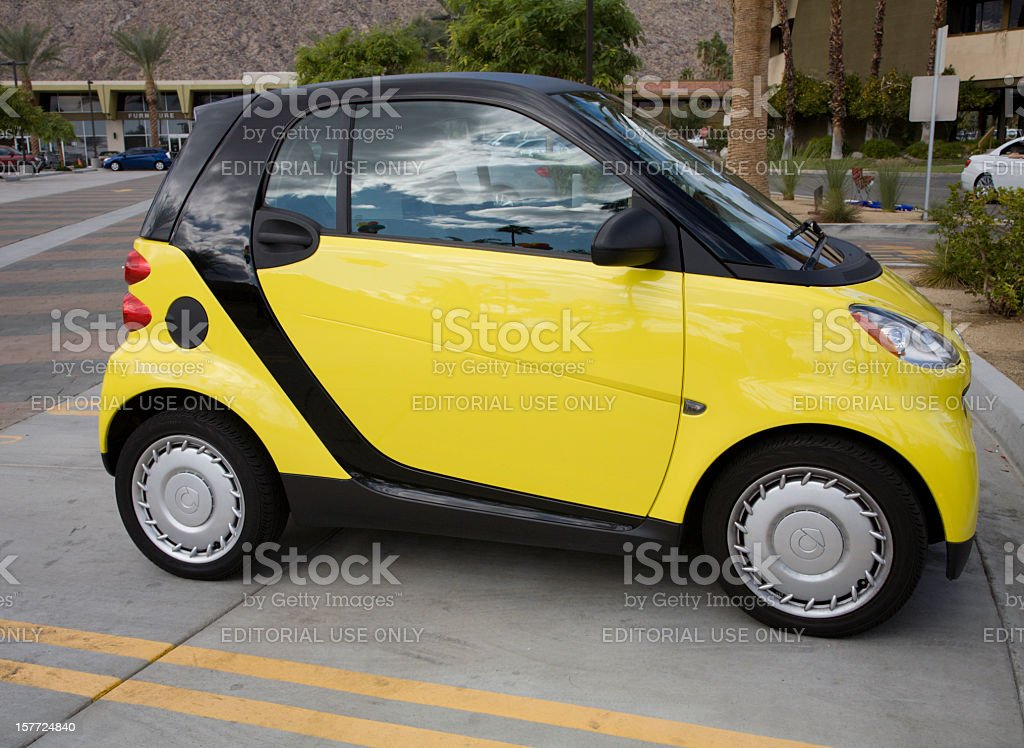 Side View Of Yellow And Black Smart Car royalty-free stock photo