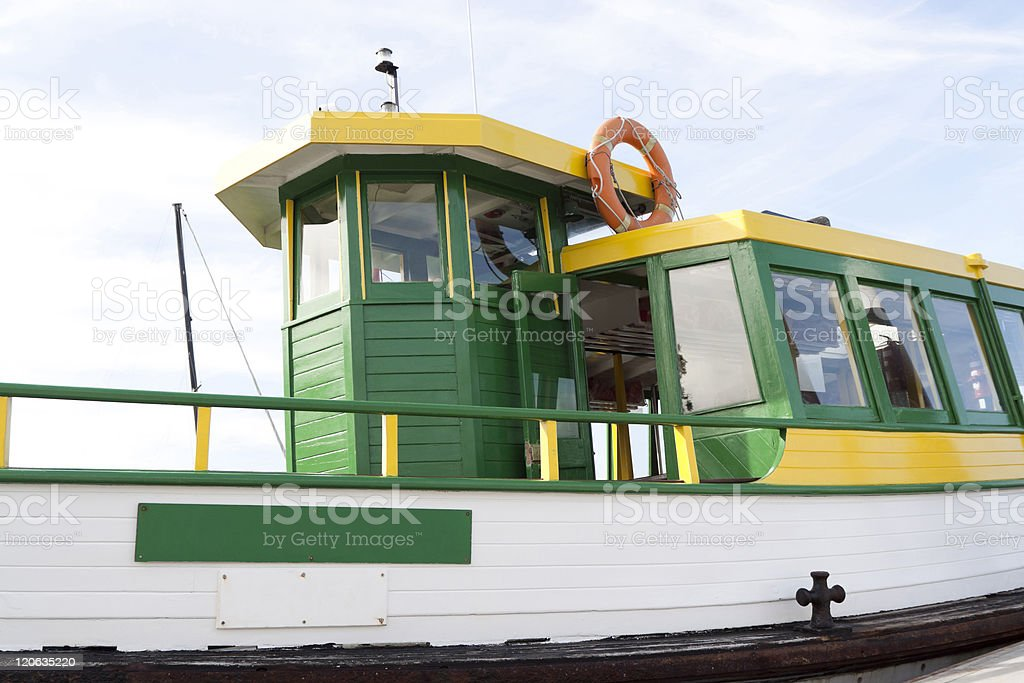 Side view of yellow and green old wooden ferry royalty-free stock photo