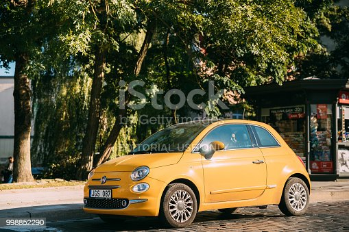 Vilnius, Lithuania - September 29, 2017: Side View Of Yellow Color Fiat 500 Car Parking On Street