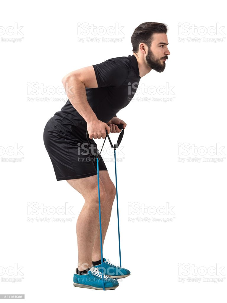 Side view of young athlete with resistance bands back exercise stock photo