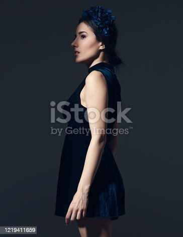 Young balkan woman portrait. she is looking away. Emotional.