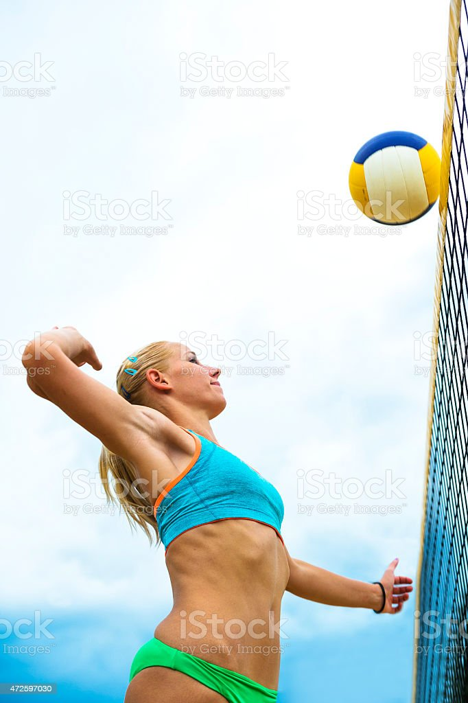 Side View of Young Female Volleyball Player in Attractive Action stock photo